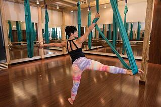 4 surprising benefits of aerial yoga