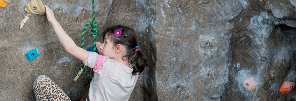 Girl climbing landing page header crop