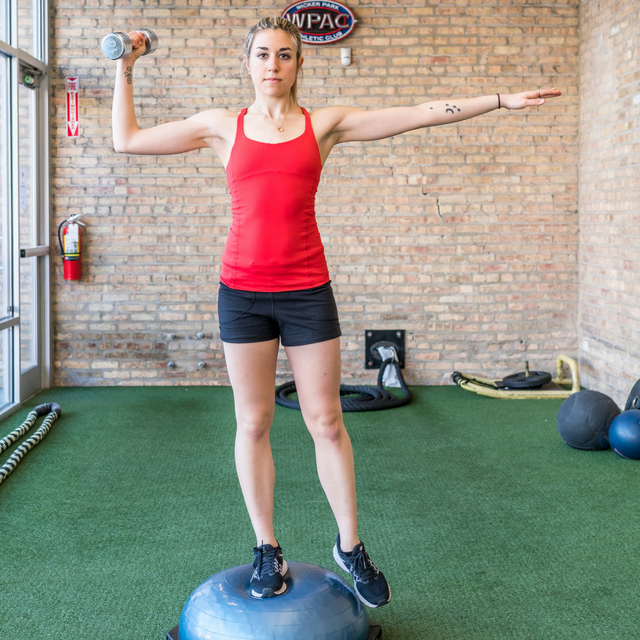 Maggie single arm press on bosu.png