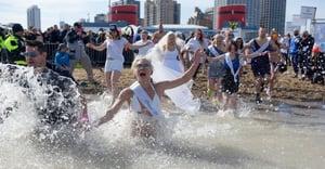 Polar Plunge bride in bikini diving in