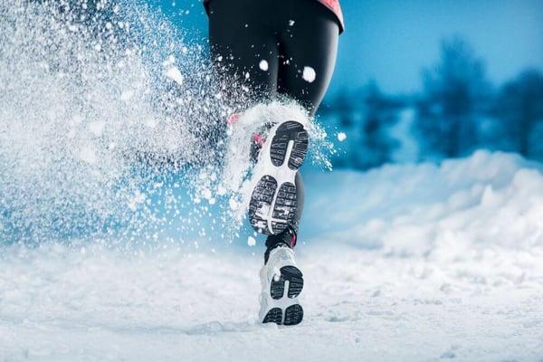 runner running in snow