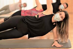 side plank in yoga class with mask